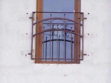Kovácsoltvas ablakrács íves